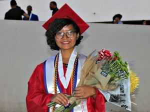 Joan graduates high school with honors in Phoenix, Ariz.