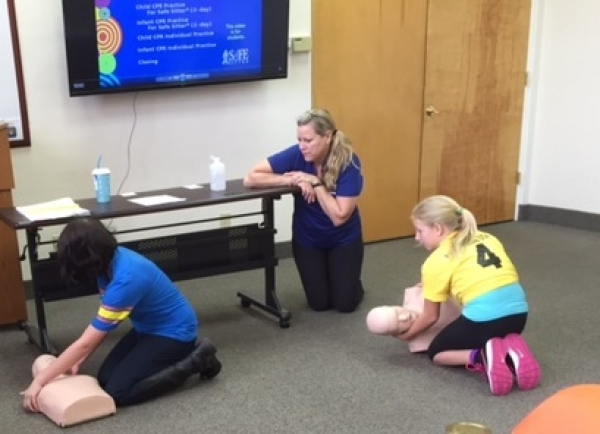 Students learn CPR at Safe Sitter class.
